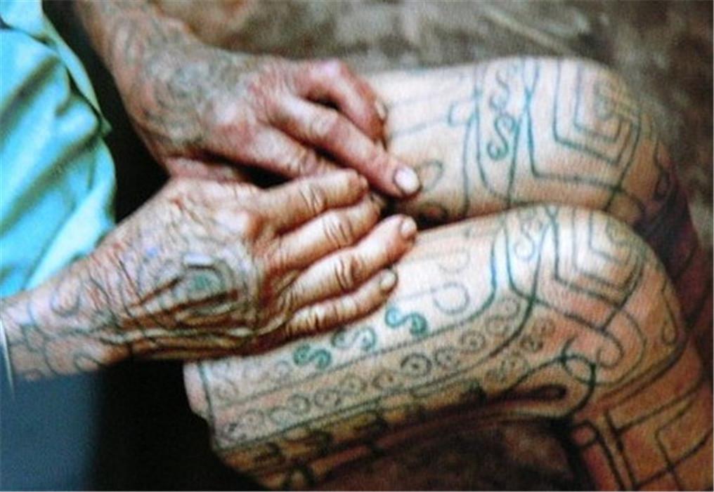 黎族纹身的起源; 成人礼; 黎族文身图片